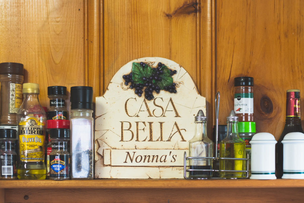 casa bella sign in nonna's kitchen at a beach house in niantic, connecticut, photographed by jamie bannon photography.