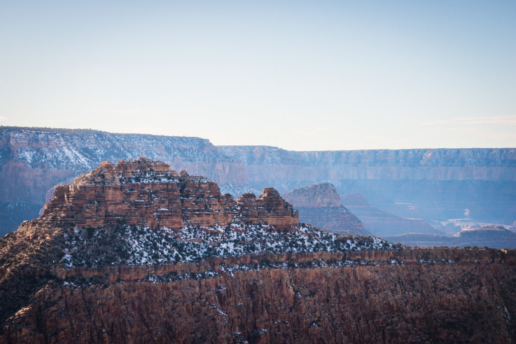 grand canyon landscape with a dusting of snow, photographed by jamie bannon photography.